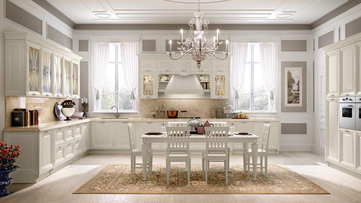 PANTHEON - luxusný model kuchyne od LUBE, ktorej masívne dvierka sú morené do šedo zelenej farby a patinované bielou